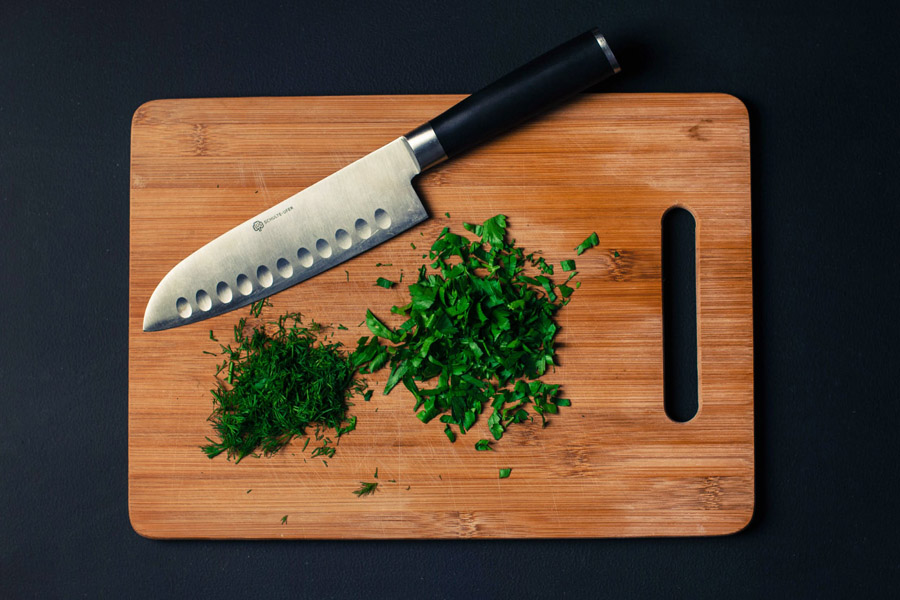 Chopping Board, Knife And Leaves